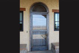 custom blackened steel storm door