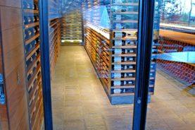 Brandner Design Machined Glass Pivot Wine Cellar Door.