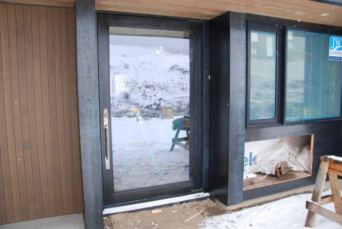modern steel pivot door