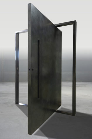 weathered black stainless steel pivot door