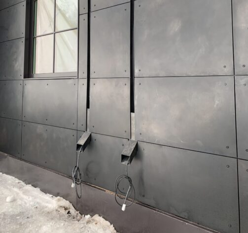 Integrated Gutter System with metal siding cladding facade